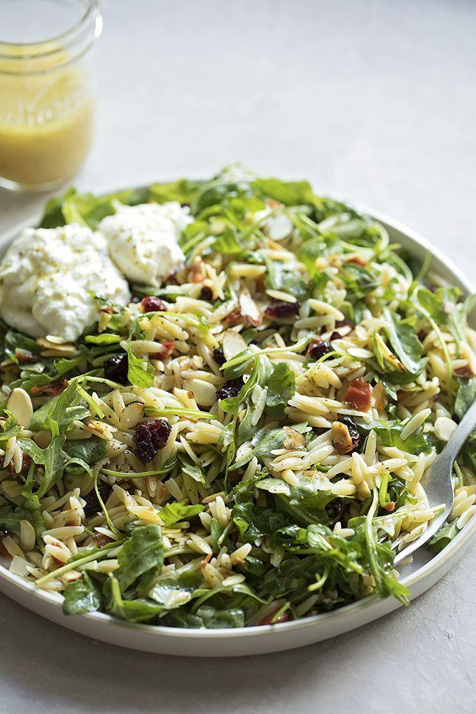 """<p>Burrata is a type of fresh mozzarella cheese filled with a rich, thick cream. It's delicious served over salads—especially when the salad has orzo pasta in it. </p><p><strong>Get the recipe at <a href=""""https://lifemadesimplebakes.com/orzo-arugula-salad-with-lemon-basil-vinaigrette/"""" rel=""""nofollow noopener"""" target=""""_blank"""" data-ylk=""""slk:Life Made Simple"""" class=""""link rapid-noclick-resp"""">Life Made Simple</a>.</strong></p>"""