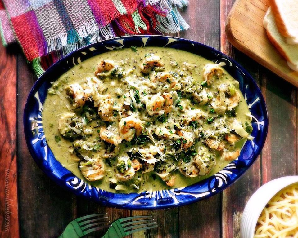"""<p>Served over rice or plain pasta, camarones con rajas consists of sauteed shrimp in a creamy sauce of garlic, onions, poblano peppers and cilantro. Be sure to add salt to the boiling water and avoid <a href=""""https://www.thedailymeal.com/how-to-cook-perfect-pasta?referrer=yahoo&category=beauty_food&include_utm=1&utm_medium=referral&utm_source=yahoo&utm_campaign=feed"""" rel=""""nofollow noopener"""" target=""""_blank"""" data-ylk=""""slk:other common pasta cooking mistakes"""" class=""""link rapid-noclick-resp"""">other common pasta cooking mistakes</a> as you prepare the noodles. </p> <p><strong><a href=""""https://www.thedailymeal.com/best-recipes/camarones-con-rajas-shrimp-poblano-pepper-pasta?referrer=yahoo&category=beauty_food&include_utm=1&utm_medium=referral&utm_source=yahoo&utm_campaign=feed"""" rel=""""nofollow noopener"""" target=""""_blank"""" data-ylk=""""slk:For the Camarones Con Rajas recipe, click here."""" class=""""link rapid-noclick-resp"""">For the Camarones Con Rajas recipe, click here. </a></strong></p>"""