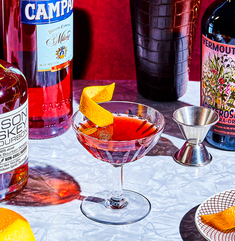 """<p><em>A whiskey cocktail for Negroni drinkers is a gift to many. The Boulevardier swaps gin out for bourbon (or rye), but remains stiff and bitter like a true Negroni fan wants.</em></p><p><strong>Ingredients<br></strong>• 1 1/2 oz. bourbon<br>• 3/4 oz. Campari<br>• 3/4 oz. vermouth rosso</p><p><strong>Directions<br></strong>1. Stir ingredients with ice in a mixing glass until chilled. <br>2. Strain into a glass, then garnish with a twist of orange peel.</p><p><a class=""""link rapid-noclick-resp"""" href=""""https://www.esquire.com/food-drink/drinks/a31467917/boulevardier-drink-recipe/"""" rel=""""nofollow noopener"""" target=""""_blank"""" data-ylk=""""slk:Read More"""">Read More</a></p>"""