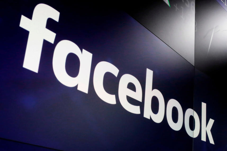 FILE- In this March 29, 2018, file photo, the logo for Facebook appears on screens at the Nasdaq MarketSite in New York's Times Square. Former President Trump will find out whether he gets to return to Facebook on Wednesday, May 5, 2021, when the social network's quasi-independent Oversight Board plans to announce its ruling in the case involving the former president. (AP Photo/Richard Drew, File)