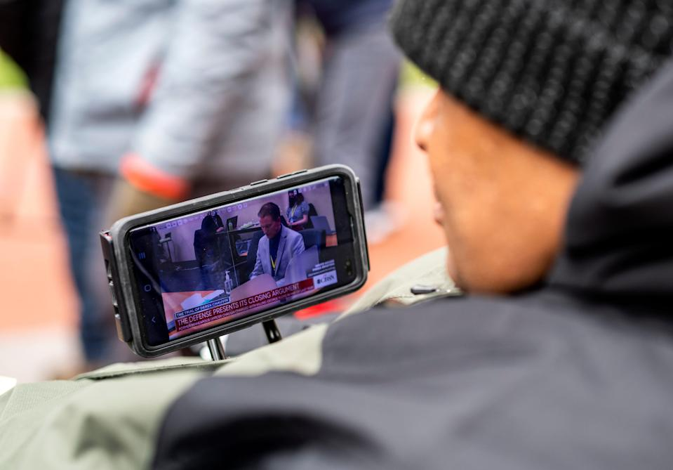 Michael Jones watches closing arguments in the Derek Chauvin trial outside the Hennepin County Government Center on April 19, 2021 in Minneapolis, Minn.