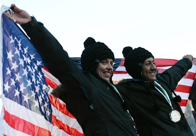 ST MORITZ, SWITZERLAND - JANUARY 26: Second placed Elana Meyers and Katie Eberling of USA celebrate after the Women's Bobsleigh final heat of the IBSF Bob & Skeleton World Championship at Olympia Bob Run on January 26, 2013 in St Moritz, Switzerland. (Photo by Lars Baron/Bongarts/Getty Images)
