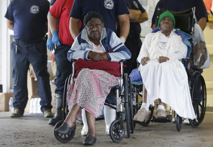 Residents of the Riverbend Nursing Center wait to be evacuated to higher and safer ground as Hurricane Isaac makes landfall, Wednesday, Aug. 29, 2012, in Jesuit Bend, La. Plaquemines Parish ordered a mandatory evacuation for the west bank of the Mississippi below Belle Chasse because of worries about a storm surge. The order affected about 3,000 people, including residents of the nursing home. (AP Photo/Eric Gay)