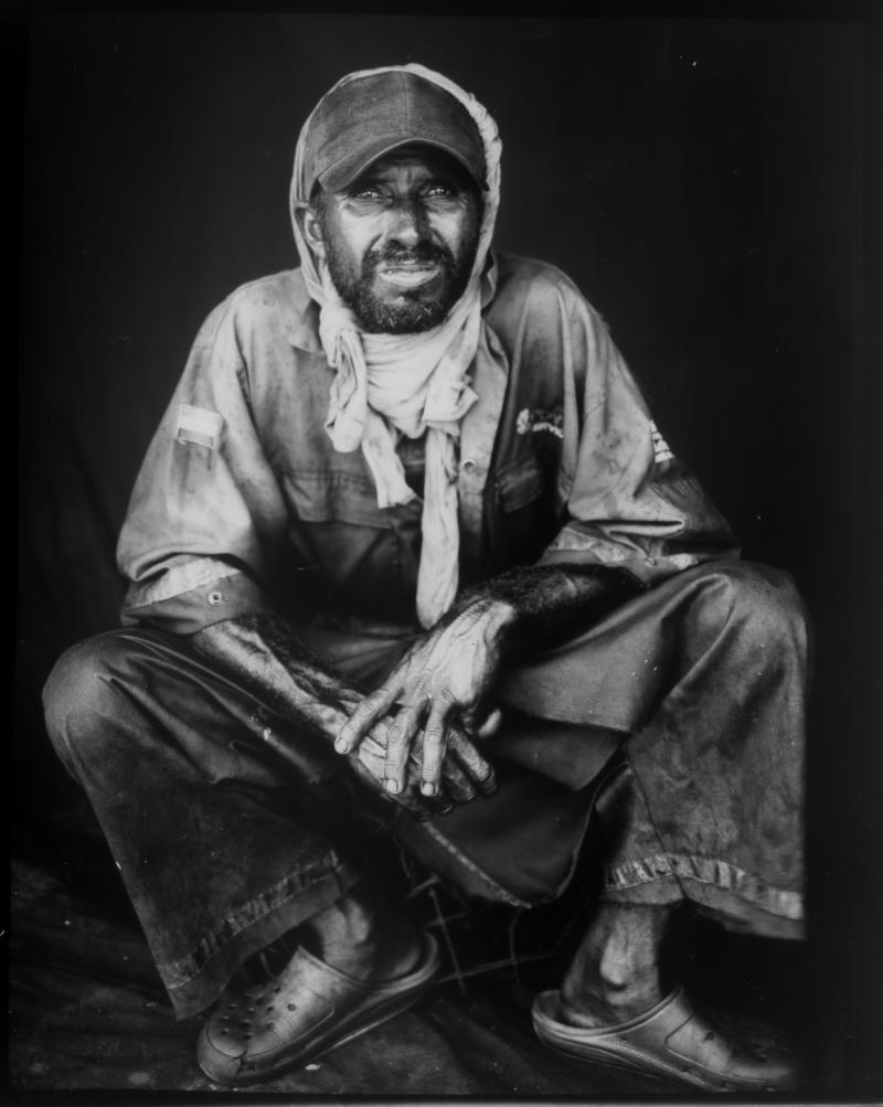 Former oil worker Jose Gregorio Romero poses for a portrait in one of his old PDVSA uniforms, which he uses to work as a fisherman, after harvesting crabs from the oil-contaminated Lake Maracaibo in Cabimas, Venezuela. (Photo: Rodrigo Abd/AP)