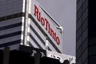 FILE PHOTO: A sign adorns the building where mining company Rio Tinto has their office in Perth, Western Australia