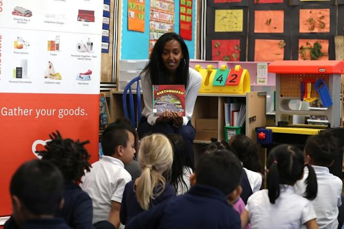 SAN FRANCISCO, CALIFORNIA - OCTOBER 17: A teacher at Rosa Parks Elementary School reads students a book about earthquakes before the start of the Great California Shakeout Earthquake Drill on October 17, 2019 in San Francisco, California. Millions of people around the world practiced how to stop, drop and hold on as they participated in the 12th ShakeOut drill that coincided with the 30th anniversary of the 1989 Loma Prieta earthquake in the San Francisco Bay Area. (Photo by Justin Sullivan/Getty Images) ** OUTS - ELSENT, FPG, CM - OUTS * NM, PH, VA if sourced by CT, LA or MoD **