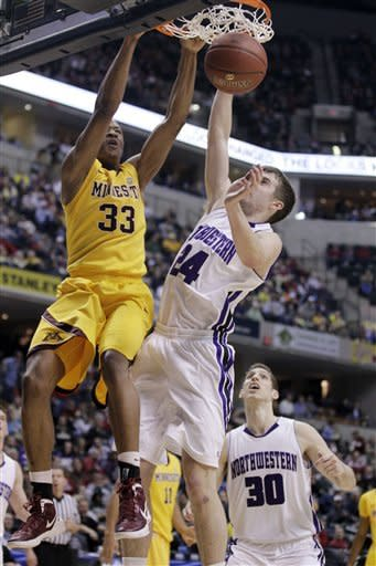 Minnesota forward Rodney Williams (33) dunks against Northwestern forward John Shurna (24) in the second half of an NCAA college basketball game at the first round of the Big Ten Conference tournament in Indianapolis, Thursday, March 8, 2012. Northwestern forward Davide Curletti (30) looks on. (AP Photo/Michael Conroy)