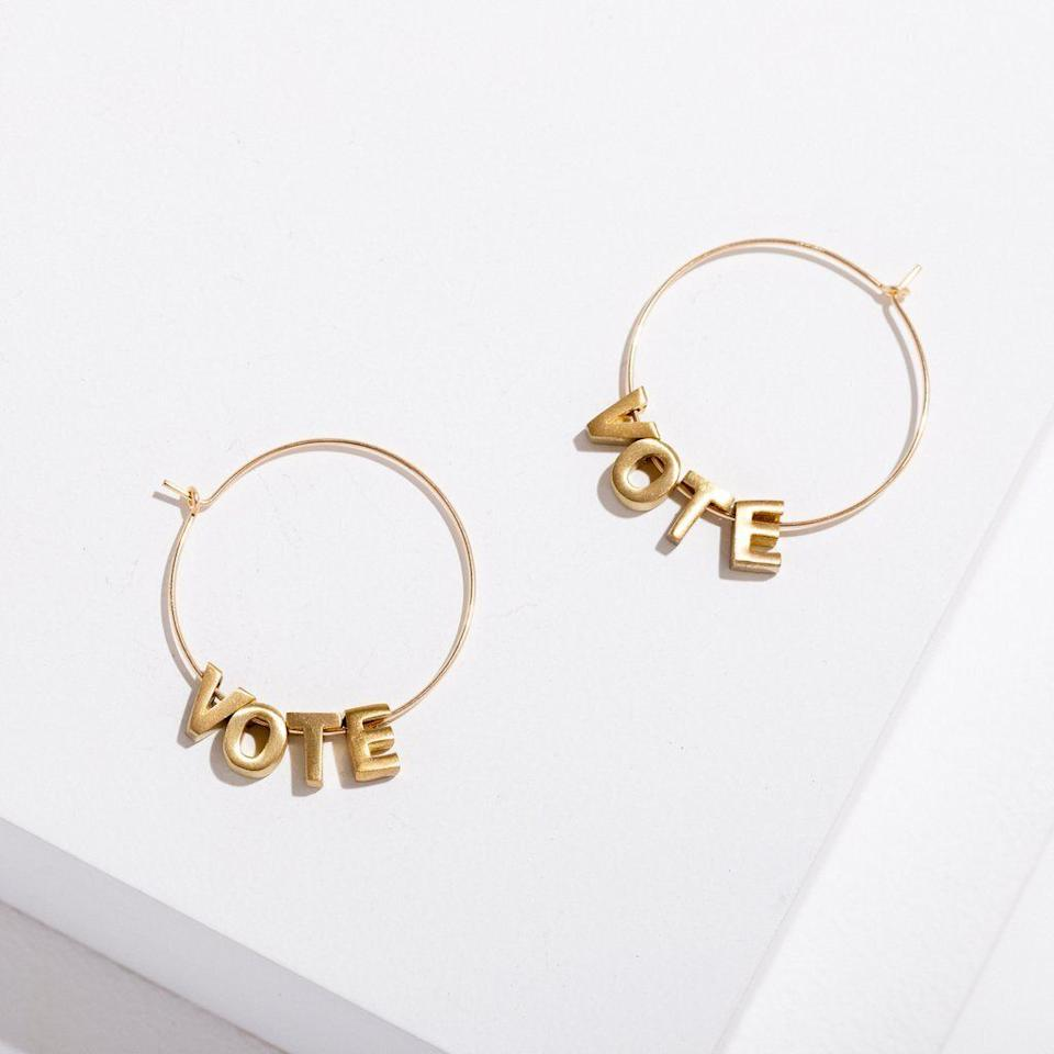"""Get the<a href=""""https://larissaloden.com/products/vote-earrings"""" target=""""_blank"""" rel=""""noopener noreferrer"""">Larissa Loden vote earrings</a> for $70."""