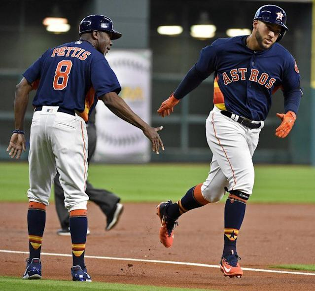 George Springer has rounded the bases quite a bit thus far. (AP Photo)