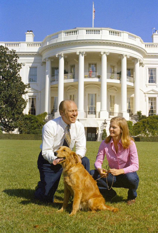 President Gerald Ford and his daughter, Susan, are seen on the South Lawn of the White House with their dog, Liberty, Oct. 7, 1974, Washington, D.C.  (AP Photo)