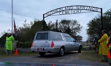 One of two hearses arrives at the cemetery for the burial of Richard and Therese Rodriguez after the husband and wife were killed in the shooting at First Baptist Church of Sutherland Springs, Texas, U.S. November 11, 2017.  REUTERS/Rick Wilking