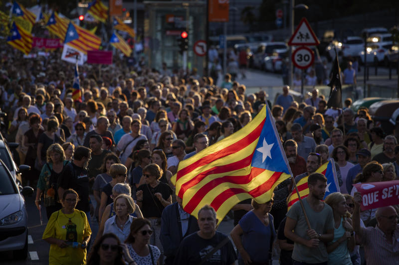 Pro-independence demonstrators march during a protest in Sabadell, near Barcelona, Spain, Saturday, Sept. 28, 2019. Several thousand people have marched in a town near Barcelona to protest the jailing of seven Catalan separatists for allegedly planning to commit violent acts of terrorism with explosives. (AP Photo/Emilio Morenatti)