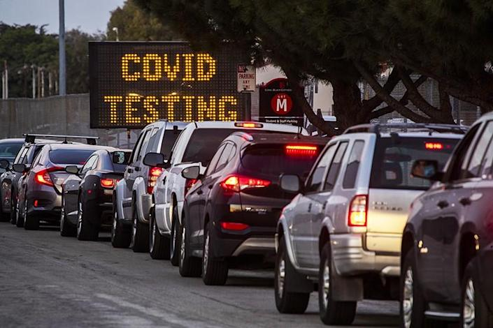 Motorists line up to take COVID-19 tests at at Long Beach City College-Veterans Memorial Stadium.