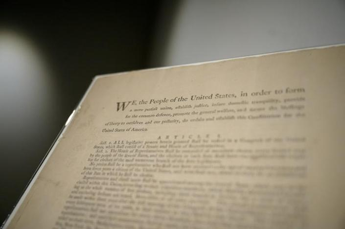 A page of the first printing of the United States Constitution is displayed at the offices of Sotheby's auction house in New York on September 17, 2021 (AFP/Ed JONES)