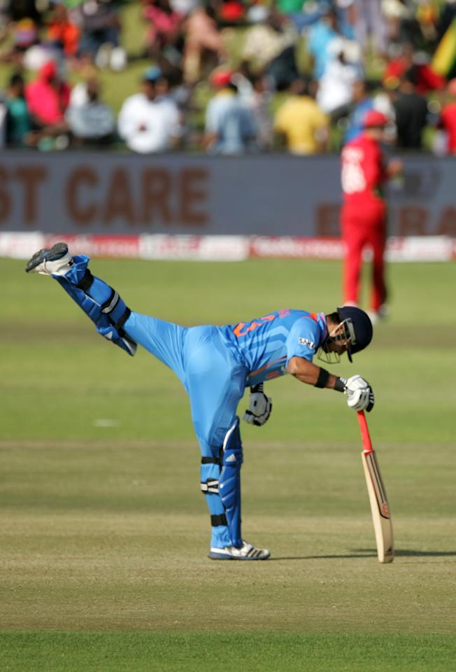 India's Suresh Raina limbers up before his batting innings during the 3rd match of the 5 cricket ODI series between Zimbabwe and India at Harare Sports Club on July 28, 2013. AFP PHOTO / JEKESAI NJIKIZANA        (Photo credit should read JEKESAI NJIKIZANA/AFP/Getty Images)