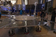Visitors to an exhibition on China's space program look at a life size model of the Chinese Mars rover Zhurong, named after the Chinese god of fire, at the National Museum in Beijing on Thursday, May 6, 2021. China has landed a spacecraft on Mars for the first time in the latest advance for its space program. The official Xinhua News Agency said Saturday, May 15, that the lander had touched down, citing the China National Space Administration. (AP Photo/Ng Han Guan)