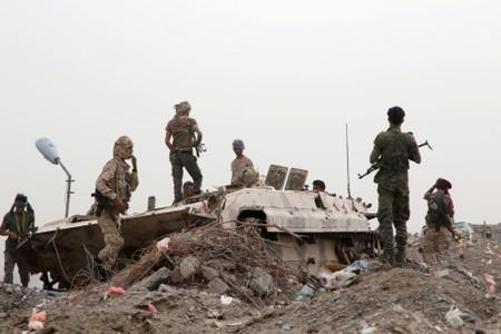 FILE PHOTO: Members of UAE-backed southern Yemeni separatist forces stand by a military vehicle during clashes with government forces in Aden