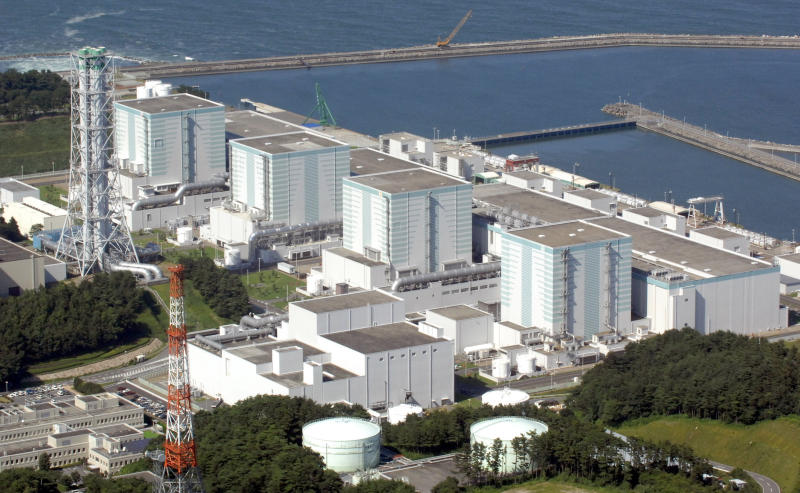 FILE - In this Aug. 10, 2006, file photo, the Fukushima Daini Nuclear Power Plant in Tomiokamachi, Fukushima Prefecture, is seen. The operator of the nuclear plant wrecked by a tsunami is considering decommissioning more reactors in northeastern Japan. Tokyo Electric Power Company Holdings says a decision is pending on dismantling the four reactors at the Fukushima Dai-ni plant. (Kyodo News via AP, File)