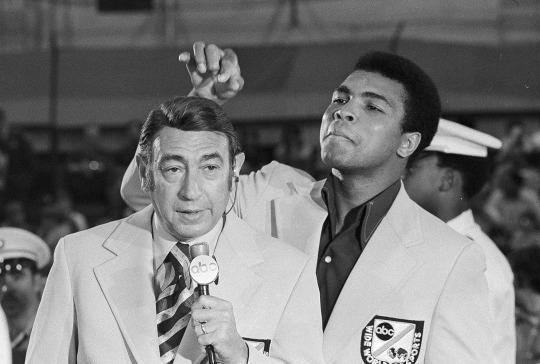 <p>Muhammad Ali, former world heavyweight boxing champion, toys with the finely combed hair of television sports commentators Howard Cosell before the start of the Olympic boxing trials, Aug. 7, 1972, in West Point, NY. (AP Photo)</p>