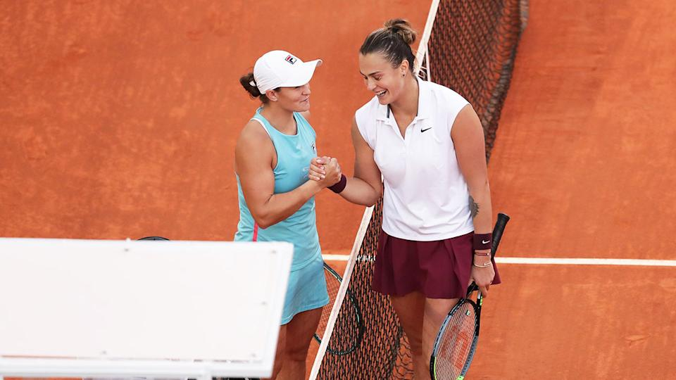 Ash Barty and Aryna Sabalenka are pictured here shaking hands after the Madrid decider.