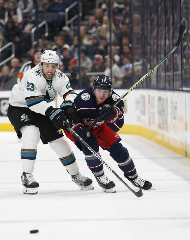 San Jose Sharks' Barclay Goodrow, left,and Columbus Blue Jackets' Gustav Nyquist, of Sweden, chase a loose puck during the second period of an NHL hockey game Saturday, Jan. 4, 2020, in Columbus, Ohio. (AP Photo/Jay LaPrete)