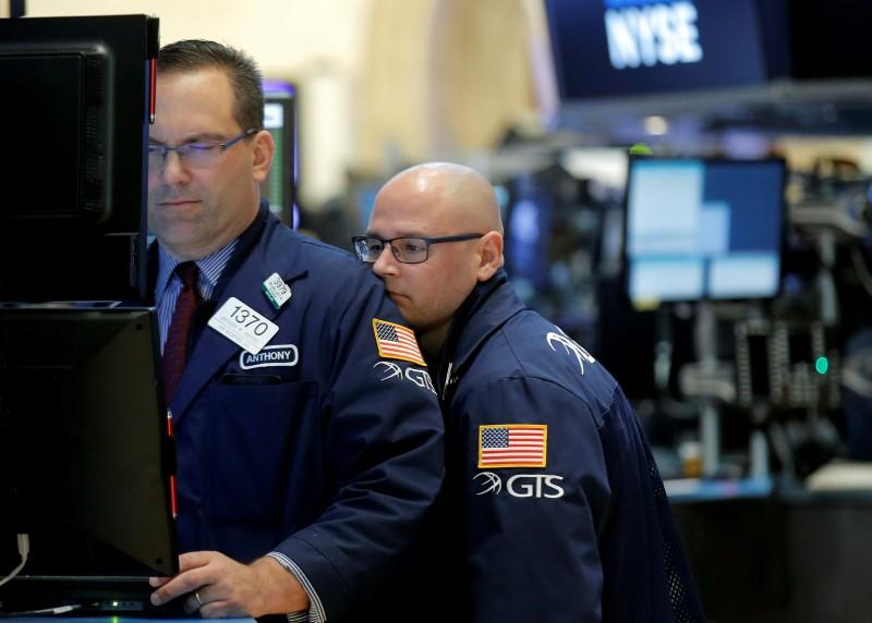 Specialist traders work at their post on the floor of the NYSE
