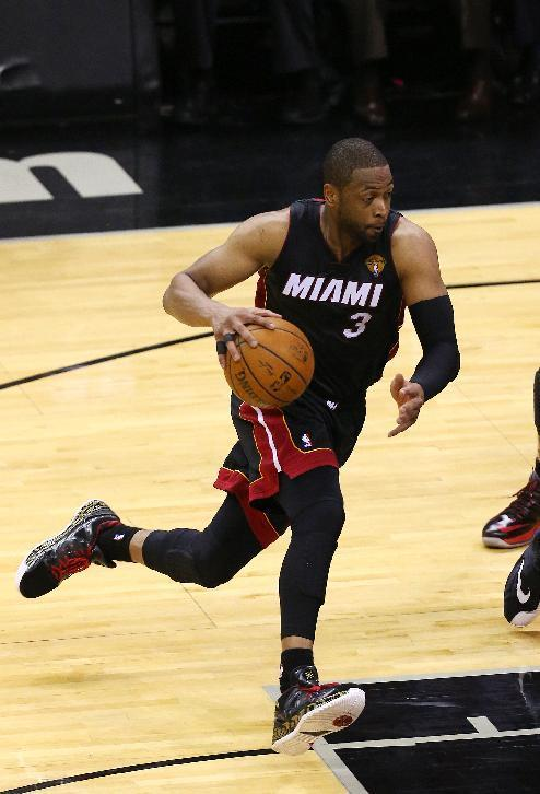 SAN ANTONIO, TX - JUNE 15: Dwyane Wade #3 of the Miami Heat drives against the San Antonio Spurs in Game Five of the 2014 NBA Finals at the AT&T Center on June 15, 2014 in San Antonio, Texas. (Photo by Chris Covatta/Getty Images)