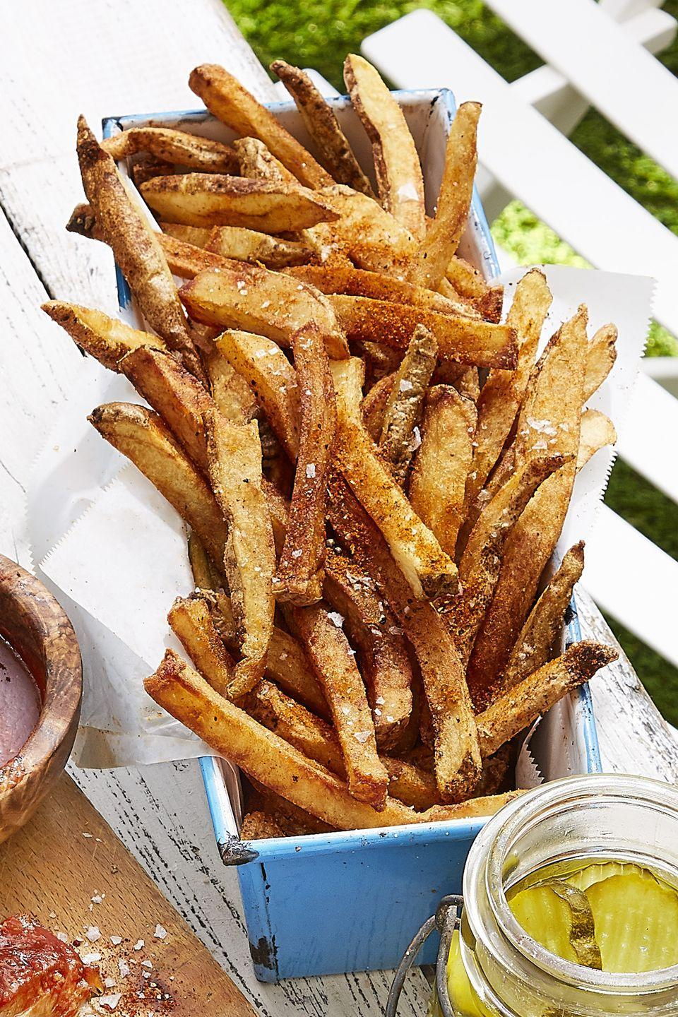 "<p>Sprinkle Old Bay seasoning on double-fried fries for an instant upgrade.</p><p><strong><a href=""https://www.countryliving.com/food-drinks/recipes/a43060/old-bay-french-fries-recipe/?visibilityoverride"" rel=""nofollow noopener"" target=""_blank"" data-ylk=""slk:Get the recipe"" class=""link rapid-noclick-resp"">Get the recipe</a>.</strong></p><p><a class=""link rapid-noclick-resp"" href=""https://www.amazon.com/Professional-Extended-Vegetable-Replacement-Non-Slip/dp/B07RWH9HCX/?tag=syn-yahoo-20&ascsubtag=%5Bartid%7C10050.g.1050%5Bsrc%7Cyahoo-us"" rel=""nofollow noopener"" target=""_blank"" data-ylk=""slk:SHOP POTATO CUTTERS"">SHOP POTATO CUTTERS</a><br></p>"