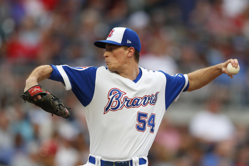 Atlanta Braves starting pitcher Max Fried works against the Cincinnati Reds in the first inning of a baseball game Thursday, Aug. 1, 2019, in Atlanta. (AP Photo/John Bazemore)