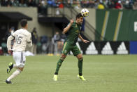 Portland Timbers defender Josecarlos Van Rankin heads the ball against Los Angeles FC during an MLS soccer match Sunday, Sept. 19, 2021, in Portland, Ore. (Sean Meagher/The Oregonian via AP)