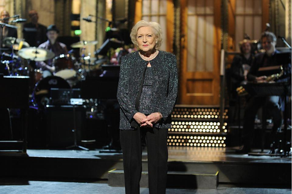 "<p>The Snickers commercial was so popular that it led to a Facebook campaign called ""Betty White to Host SNL (Please)"" where fans begged the show to have White as a host. A few months later it was announced that White would take it on, becoming the oldest person to host <em>Saturday Night Live</em> at age 88. White told DeGeneres <a href=""https://www.youtube.com/watch?v=60c9Rc0pw2c"" rel=""nofollow noopener"" target=""_blank"" data-ylk=""slk:in an interview"" class=""link rapid-noclick-resp"">in an interview</a> that she had always turned down the hosting role because it was ""scary."" She said she was, ""scared to death"" to do the show. It ended up getting her an Emmy for Outstanding Guest Actress in a Comedy Series.<br></p>"
