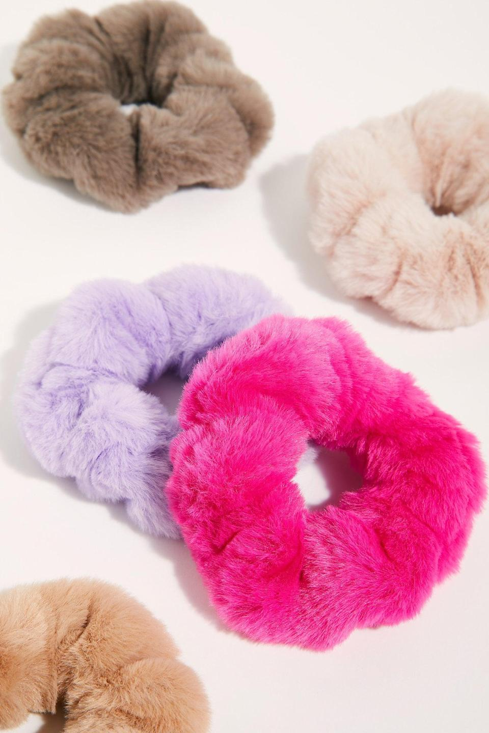 """<p>Who could refuse this <a href=""""https://www.popsugar.com/buy/Faux-Fur-Scrunchie-527148?p_name=Faux%20Fur%20Scrunchie&retailer=freepeople.com&pid=527148&price=8&evar1=fab%3Aus&evar9=45460327&evar98=https%3A%2F%2Fwww.popsugar.com%2Ffashion%2Fphoto-gallery%2F45460327%2Fimage%2F46977998%2FFaux-Fur-Scrunchie&list1=shopping%2Cgifts%2Cfree%20people%2Choliday%2Cgift%20guide%2Cgifts%20for%20women&prop13=api&pdata=1"""" class=""""link rapid-noclick-resp"""" rel=""""nofollow noopener"""" target=""""_blank"""" data-ylk=""""slk:Faux Fur Scrunchie"""">Faux Fur Scrunchie</a> ($8)?</p>"""