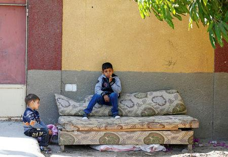 Children from families who fled their homes in Arish sit outside a rented apartment on the edge of Suez Canal in Ismailia, Egypt, April 24, 2017. Picture taken April 24, 2017. REUTERS/Mohamed Abd El Ghany