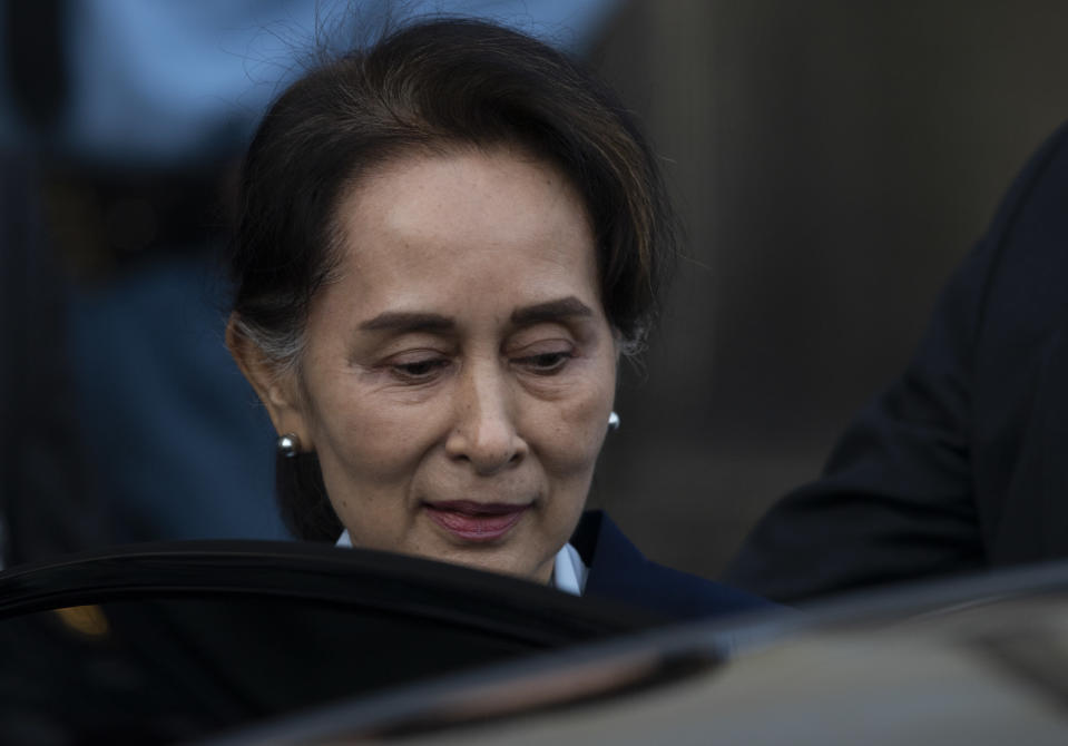 Myanmar's leader Aung San Suu Kyi leaves the International Court of Justice after addressing judges on the second day of three days of hearings in The Hague, Netherlands, Wednesday, Dec. 11, 2019. Aung San Suu Kyi defended Myanmar and denied genocide accusations in a case filed by Gambia at the ICJ, the United Nations' highest court, accusing Myanmar of genocide in its campaign against the Rohingya Muslim minority. (AP Photo/Peter Dejong)