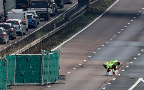 Officers gather evidence on the motorway - Credit: Gareth Fuller /PA