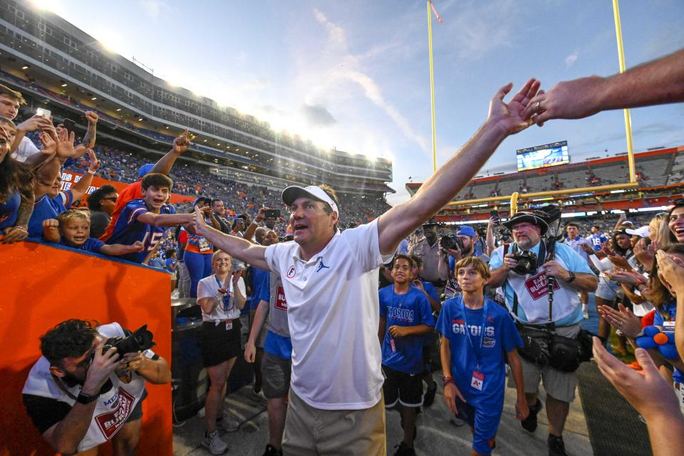 Florida Gators head coach Dan Mullen walks off the field after defeating the Auburn Tigers on Saturday. (USAT)