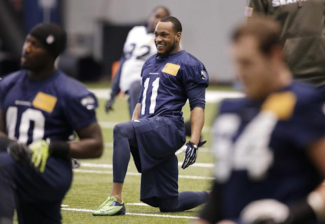 Seattle Seahawks' Percy Harvin (11) smiles as he stretches during NFL football practice Tuesday, Jan. 7, 2014, in Kirkland, Wash. The Seahawks host the New Orleans Saints on Saturday in an NFC divisional playoff game. (AP Photo/Elaine Thompson)