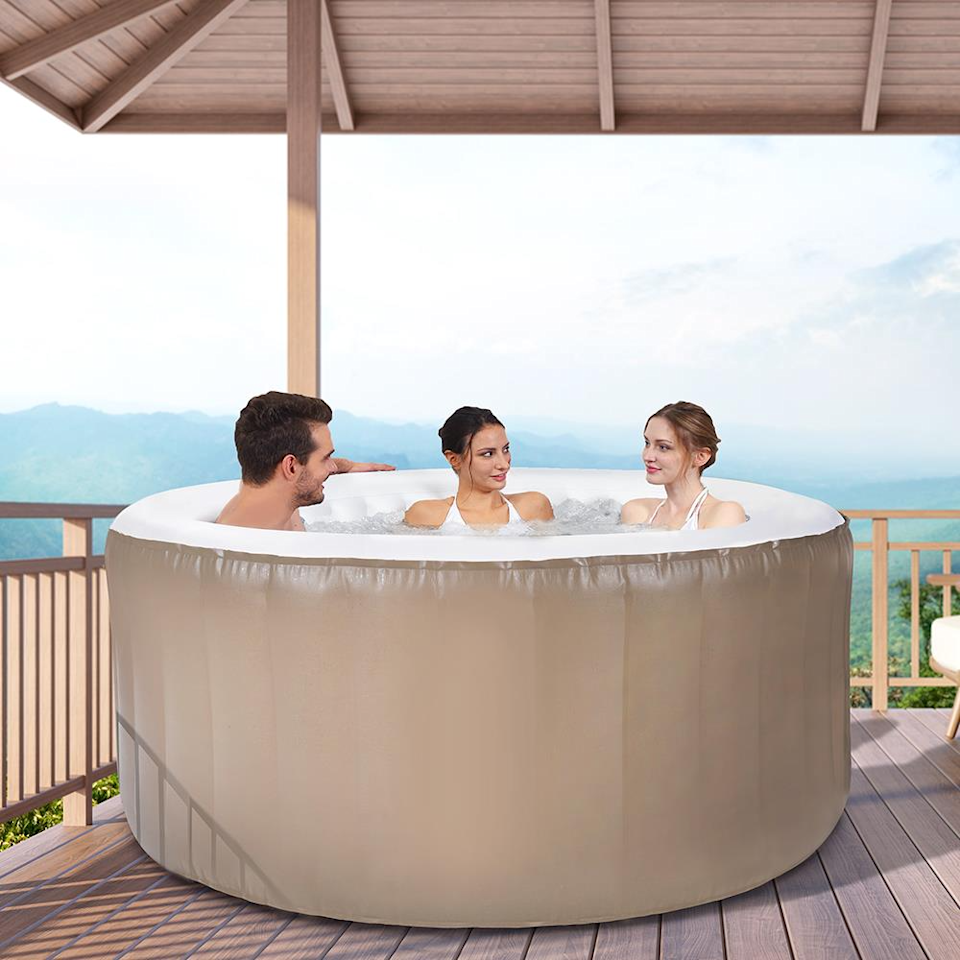 """<h2>Hammacher Schlemmer The Three Person Inflatable Massaging Spa</h2><br>Soothe your muscles in this sleek inflatable whirlpool spa that features 105 high-powered jets.<br><br><strong>Capacity:</strong> 3 people<br><strong>Features: </strong>Digital control panel, 105 jets, water filtration system.<br><strong>Includes: </strong>Two filters, floor protector, and locking insulated cover.<br><br><br><strong>Hammacher Schlemmer</strong> The Three Person Inflatable Massaging Spa, $, available at <a href=""""https://go.skimresources.com/?id=30283X879131&url=https%3A%2F%2Fwww.hammacher.com%2Fproduct%2Fthree-person-inflatable-massaging-spa"""" rel=""""nofollow noopener"""" target=""""_blank"""" data-ylk=""""slk:Hammacher Schlemmer"""" class=""""link rapid-noclick-resp"""">Hammacher Schlemmer</a>"""