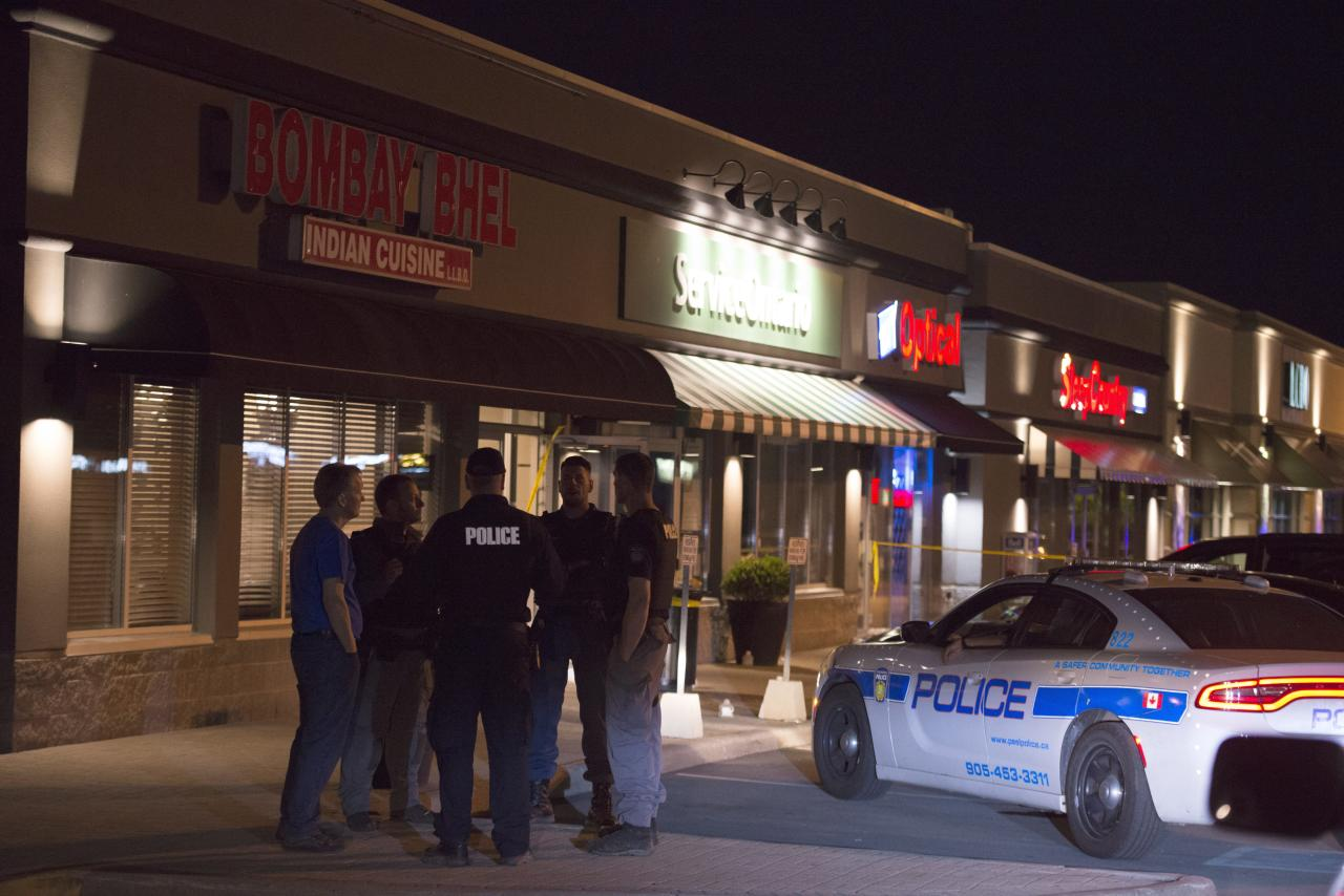 "<p>Police stand outside the Bombay Bhel restaurant in Mississauga, Ont. on May 25. Fifteen people were injured on May 24 when an explosion police say was caused by an ""improvised explosive device"" ripped through a restaurant in Mississauga. Ontario. (Photo from The Canadian Press/Doug Ives) </p>"
