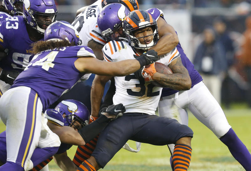 CHICAGO, ILLINOIS - SEPTEMBER 29: David Montgomery #32 of the Chicago Bears is tackled by Anthony Barr #55 and Eric Kendricks #54 of the Minnesota Vikings during the second half at Soldier Field on September 29, 2019 in Chicago, Illinois. (Photo by Nuccio DiNuzzo/Getty Images)