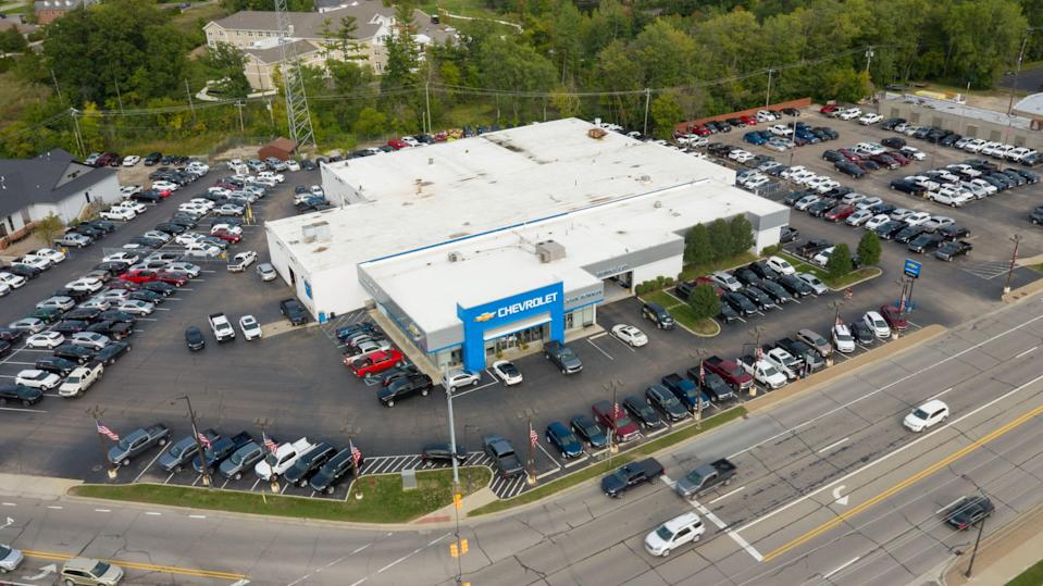 An aerial photo of Bowman Chevrolet in Clarkston on May 3, 2021. The store only has about a third of the new car inventory it would usually have because of a semiconductor chip shortage that has caused GM and other automakers to halt some production.