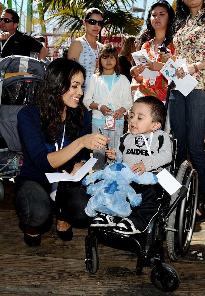 "Who knew hottie Rosario Dawson was such a sweetheart?! The ""Sin City"" actress shared a special moment with a Make-A-Wish child during one of several appearances she made at charity events over the weekend. Stefanie Keenan/<a href=""http://www.gettyimages.com/"" target=""new"">GettyImages.com</a> - March 14, 2010"