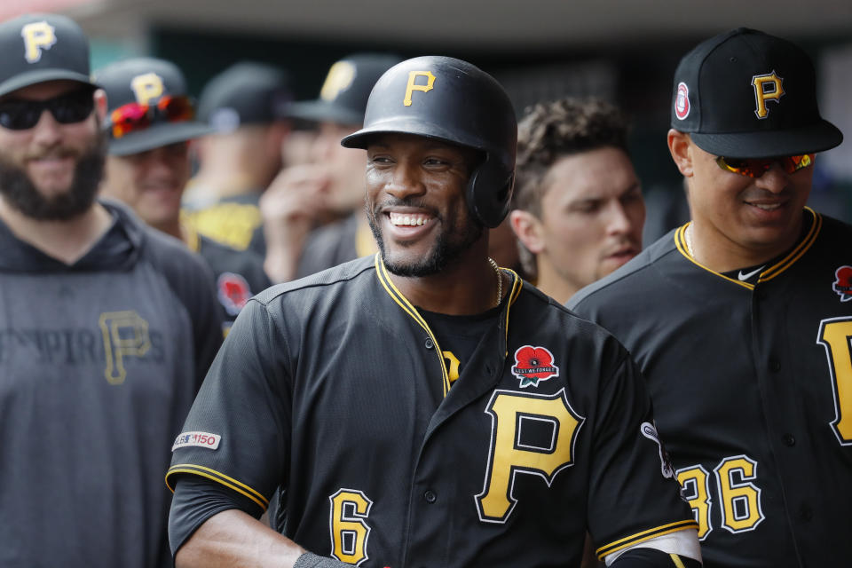Pittsburgh Pirates' Starling Marte (6) celebrates in the dugout after hitting a two-run home run off Cincinnati Reds relief pitcher David Hernandez in the eighth inning during the first baseball game of a doubleheader, Monday, May 27, 2019, in Columbus. (AP Photo/John Minchillo)