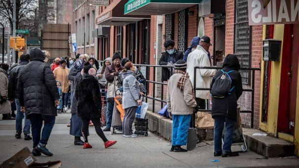 PHOTO: People stand in line outside a food pantry in the Bedford-Stuyvesant neighborhood of Brooklyn, New York, during the coronavirus pandemic, March 19, 2020. (Erin Patrice O'Brien/Redux)