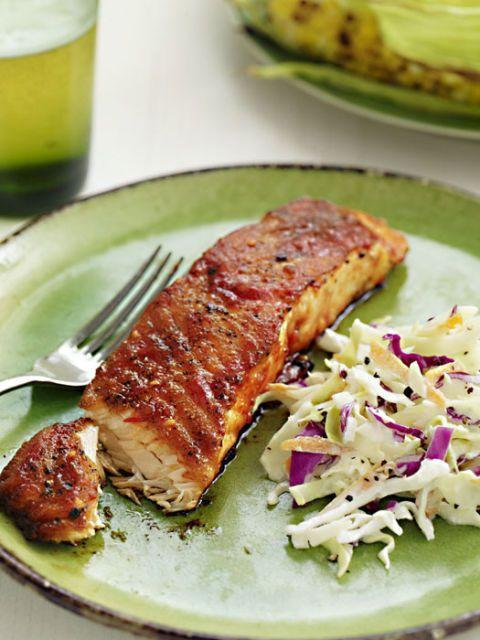 """<p>Turn up the heat by adding a sweet and spicy glaze to your salmon before throwing it on the grill. </p><p><em><strong><a href=""""https://www.womansday.com/food-recipes/food-drinks/recipes/a31552/barbecue-glazed-salmon-recipe-rbk0610/"""" rel=""""nofollow noopener"""" target=""""_blank"""" data-ylk=""""slk:Get the recipe for Barbecue-Glazed Salmon"""" class=""""link rapid-noclick-resp"""">Get the recipe for Barbecue-Glazed Salmon</a></strong></em>. </p>"""