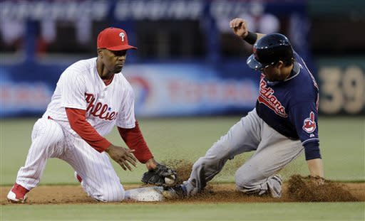 Cleveland Indians' Jason Kipnis, right, steals second base as Philadelphia Phillies shortstop Jimmy Rollins applies the tag in the third inning of a baseball game, Tuesday, May 14, 2013, in Philadelphia. (AP Photo/Matt Slocum)