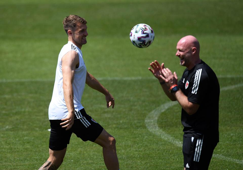 Aaron Ramey (left) with Wales interim manager Robert Page during a training session in Baku (PA Wire)