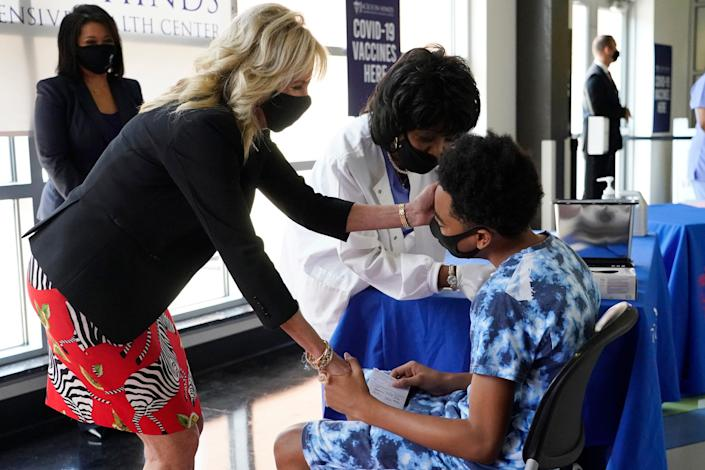 Jill Biden encourages a patient as he gets vaccinated in Jackson, Miss. June 22, 2021.