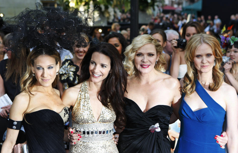 From left, U.S. actors Sarah Jessica Parker, Kristin Davis, Kim Cattrall, and Cynthia Nixon pose for photographers as they arrive for the British premiere of 'Sex and the City 2', at a central London cinema, Thursday, May 27, 2010. (AP Photo/Lefteris Pitarakis)