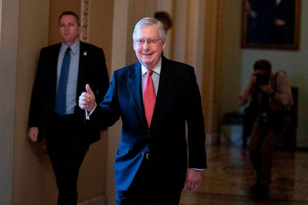 PHOTO: Senate Majority Leader Mitch McConnell smiles as he leaves the Senate floor at the U.S. Capitol, March 25, 2020, in Washington. (Alex Edelman/AFP via Getty Images)